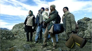 Szenenbild: Die Emigranten auf der Flucht