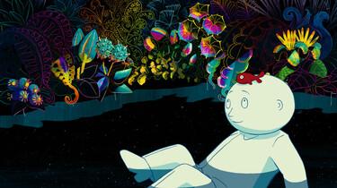 Szenenbild: Der Mondmann vor Blüten